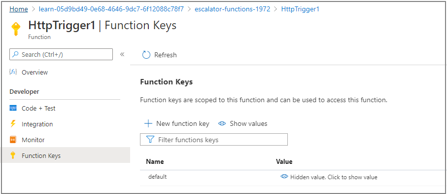 Screenshot of the Azure portal showing the function Manage blade with the revealed function key highlighted.
